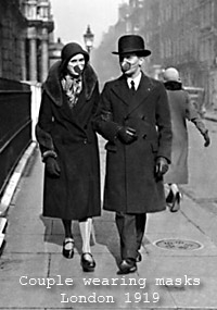 Couple wearing masks London 1919